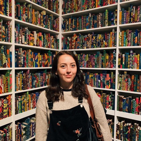 Publisher standing in front of bookshelves