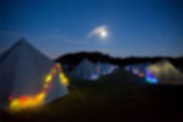 Row of Bell Tents at ight