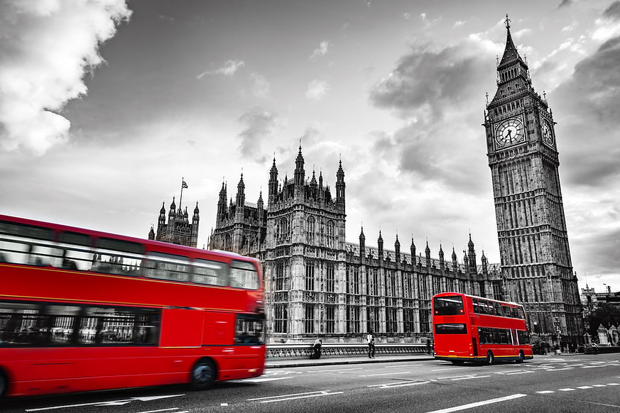 London, the UK. Red buses in motion and