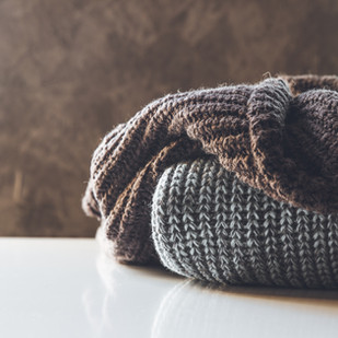 a-stack-of-knitted-sweaters-the-concept-