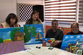 Stroke survivors holding painting they created