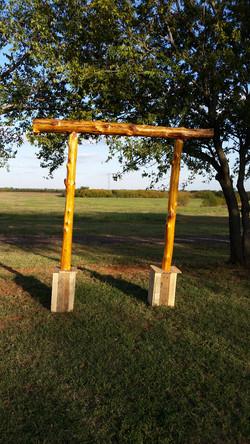 Cedar Post Wedding Arch