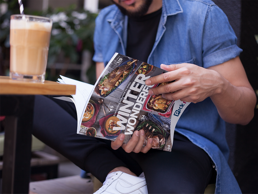 young-guy-reading-a-magazine-while-drink