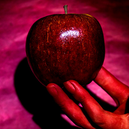 Red Hand under Red Apple on Red
