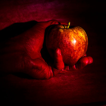 Red Apple, Red Hand, on Red