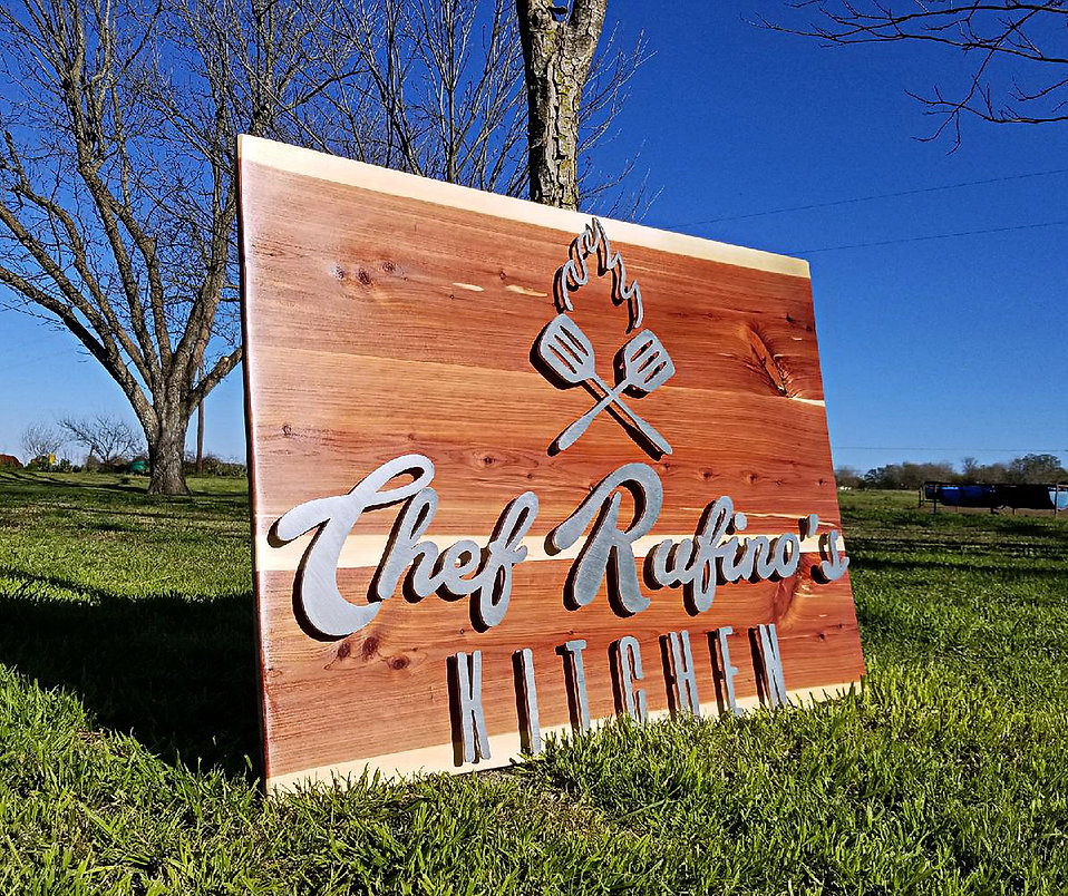 Chef Rufino's Kitchen Sign at an angle