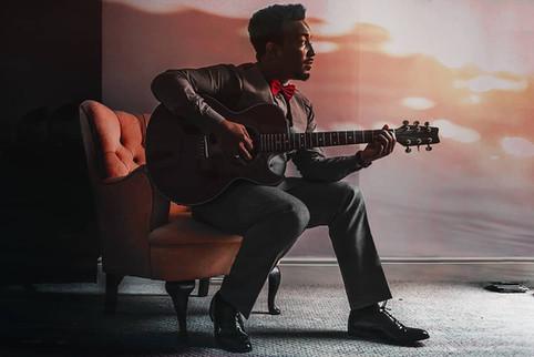 Darren Charles playing his guitar