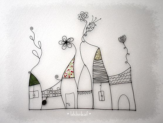 Village de maisons fleurs en fil de fer