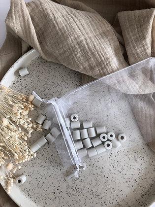 """Sachet de 50 perles de céramique spécial """"Lave-linge"""""""