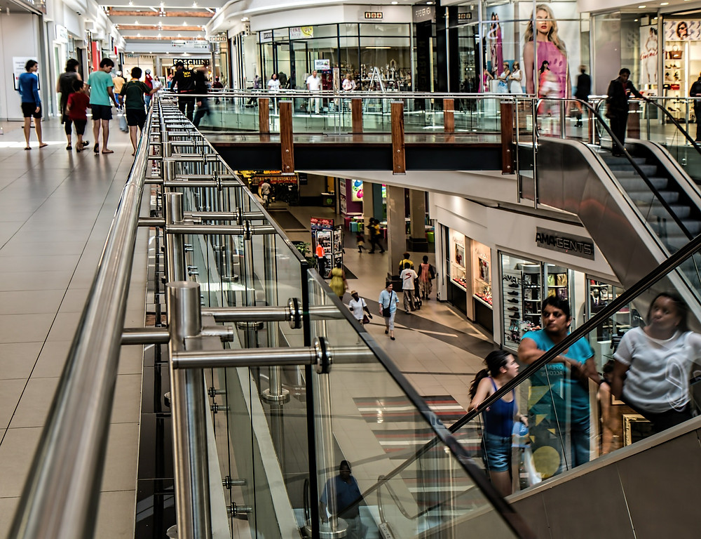 Shoppers inside a luxury shopping mall