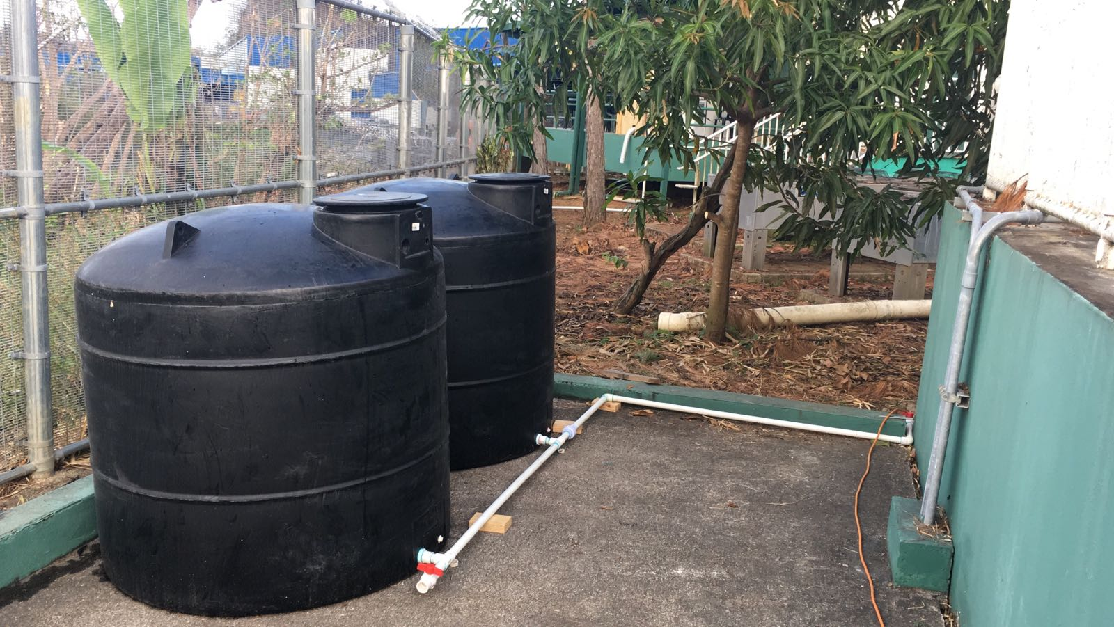 Two of four 800 gallon Poly tanks and pump installed at Bayamon Leased space