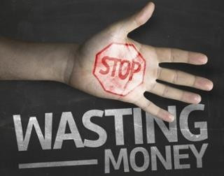 Hand imprinted with the words stop wasting money
