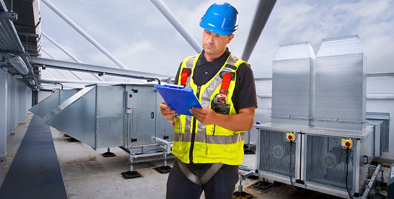 Experienced technician performs scheduled maintenance on HVAC unit