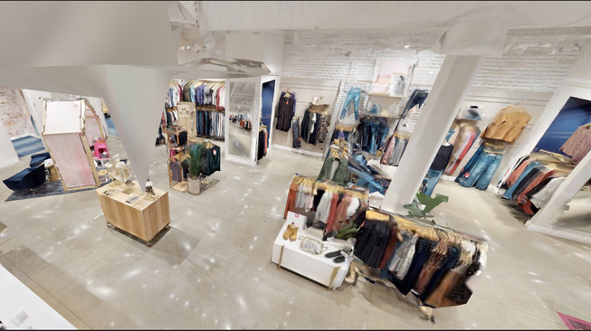 Drone footage captured inside a small box retail store