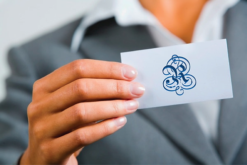 Business card hand with logo.png