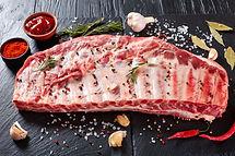 rack of raw pork spare ribs seasoned wit