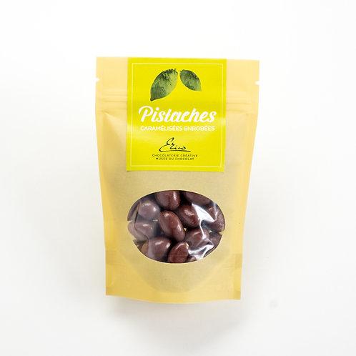 Pistaches caramélisées enrobées de chocolat au lait. 100g
