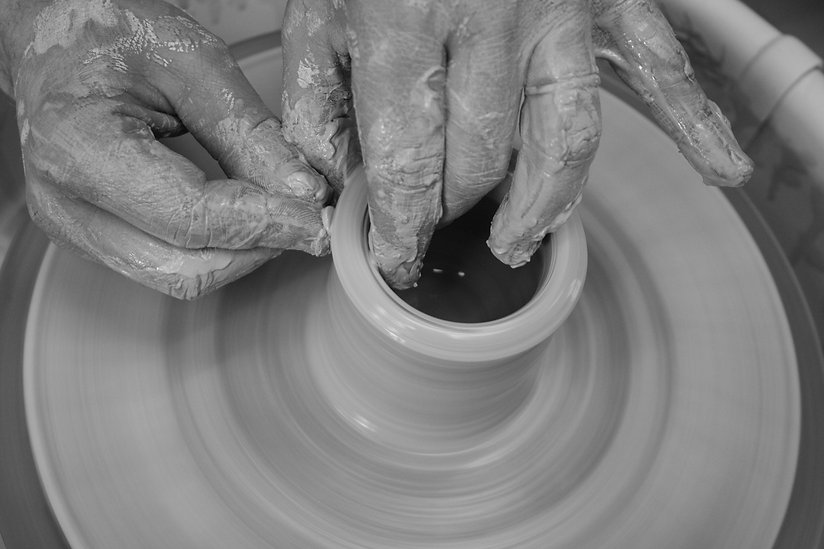 Working the wheel at The Pottery in Toronto