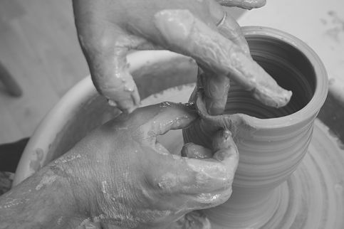 Forming clay on a pottery wheel