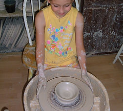 Camper making a ceramic bowl