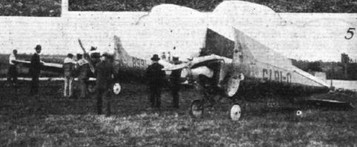 THE FOLDING TEST AT ORLY: (5) Two of the German B.F.W. monoplanes, some of which were fitted with Genet engines and others with Siemens and Halske engines.