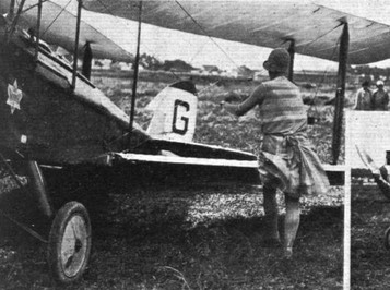 THE FOLDING TEST AT ORLY: (3) Miss Winifred Spooner's Gypsy Moth essaying the test with ease