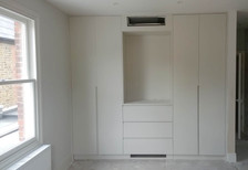 Fitted wardrobes with integrated ventilation.