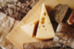 sliced-cheese-on-brown-table-top-821365.