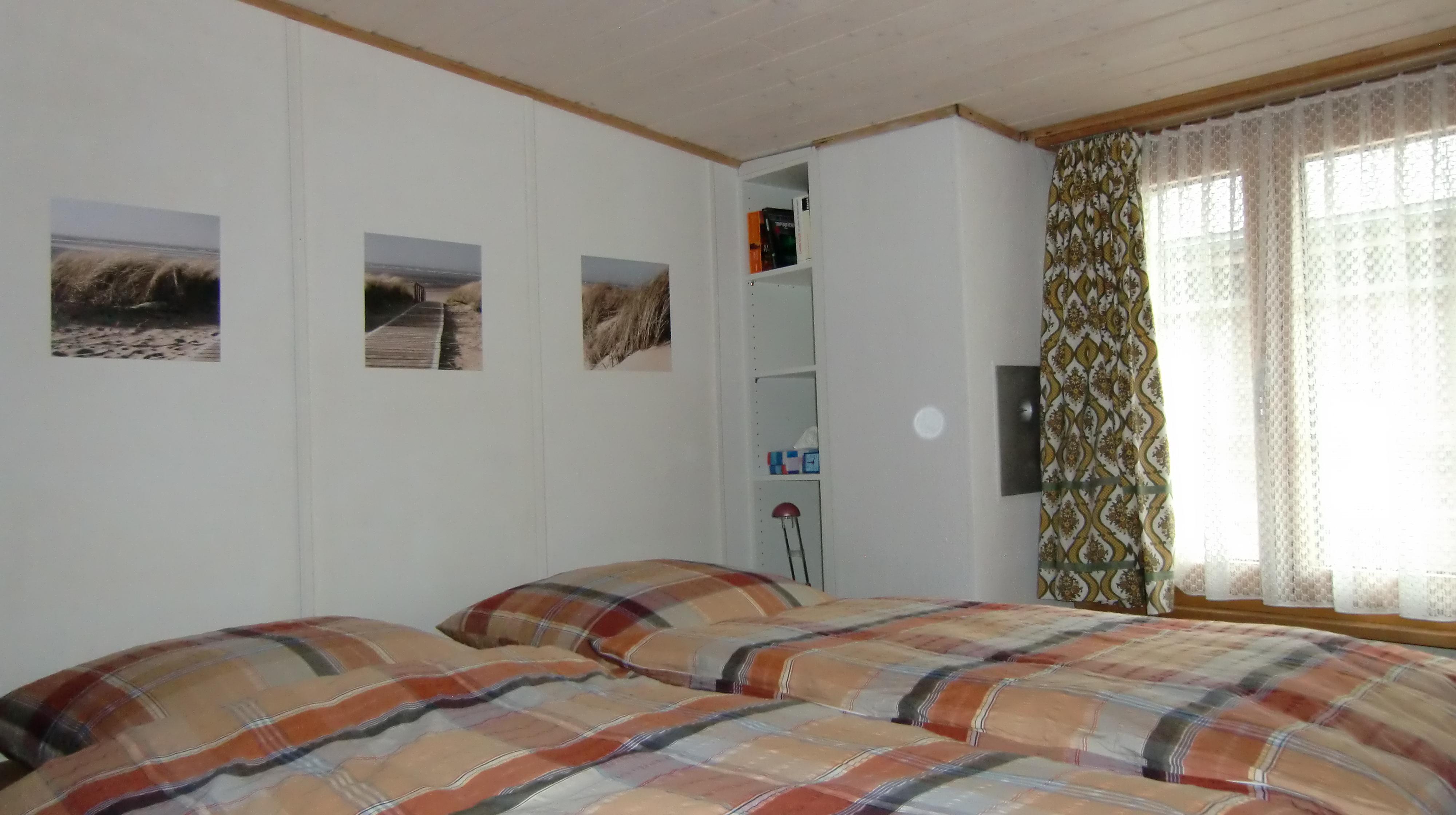 Schlafzimmer_mit_Doppelbett