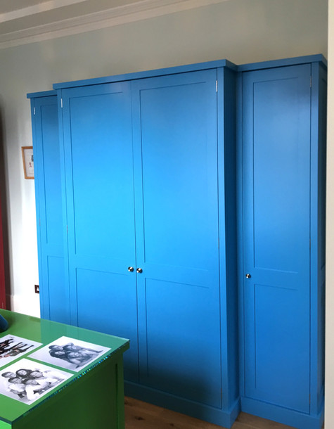 Electric blue painted wardrobe with shaker style doors