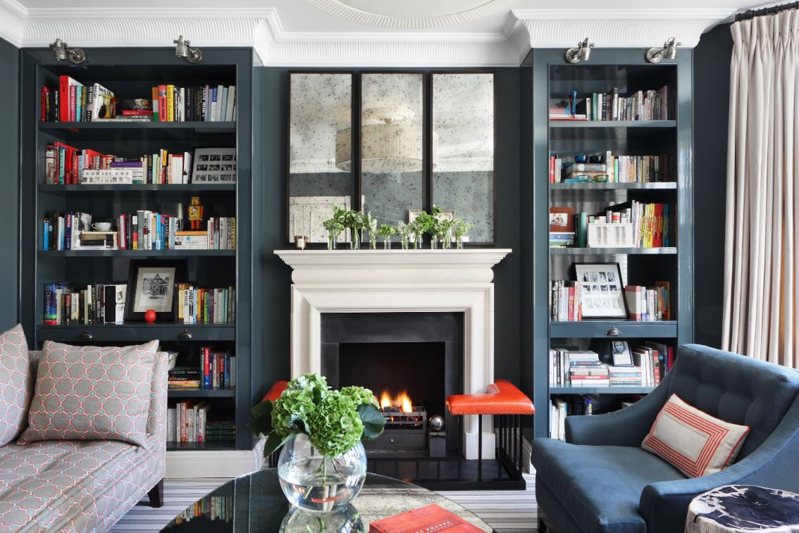 Pair of alcove bookcases with cock beading details and pull out drinks trays Interior designer - Turner Pocock