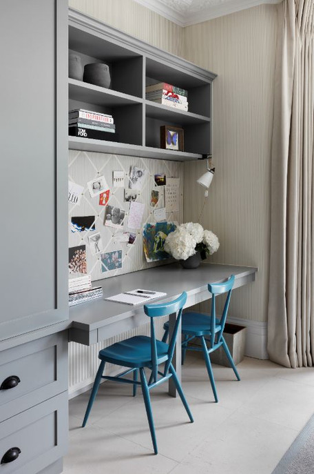 Double desk with pencil drawers and bookshelves above Interior designer - Turner Pocock