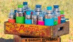 Pura Bottles in a crate
