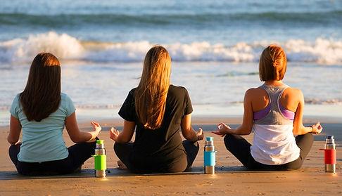 Pura Bottles - women on a beach