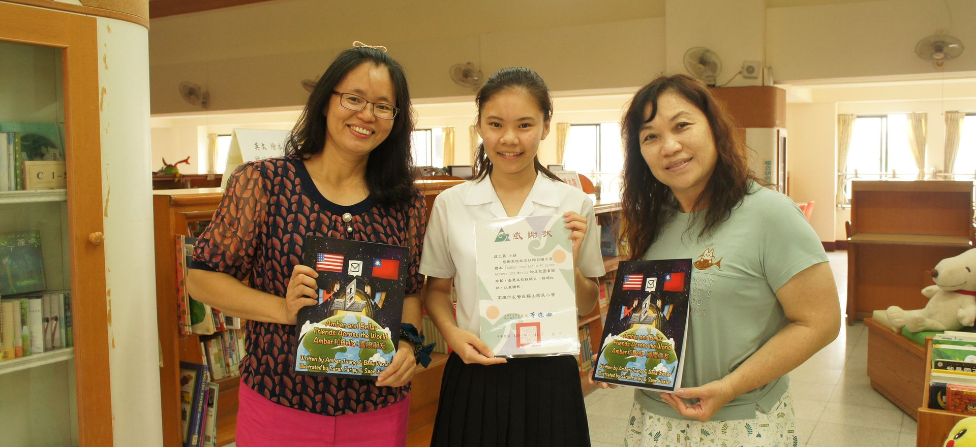 Students enjoy award-winning artwork by kids around the world at the art exhibition!