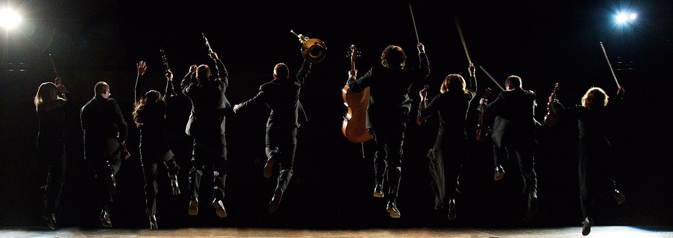 9 Core Musicians Jumping_edited.jpg
