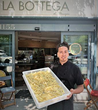 alessandro in front of la bottega with pasta.jpg
