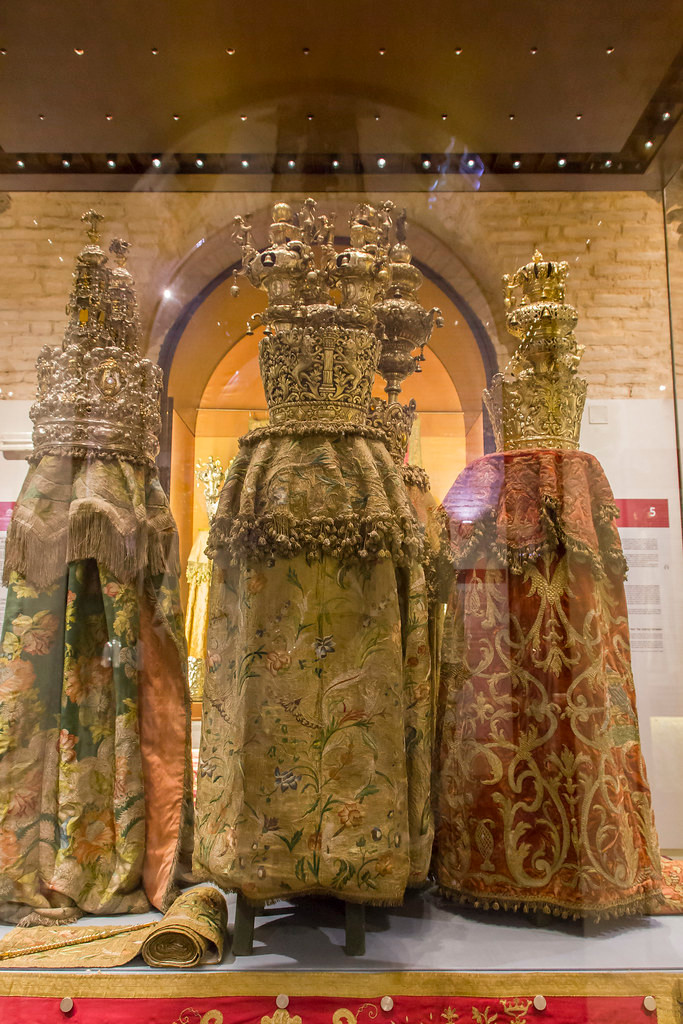 Three antique Italian Torah mantles in a case at the Jewish Museum, Rome.