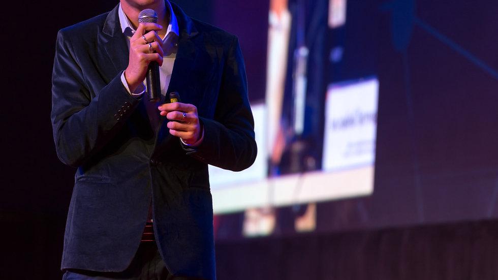 speaker-giving-talk-conference-hall-busi