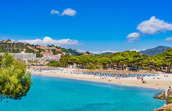 Santa ponsa beach in mallorca with mountains at the back