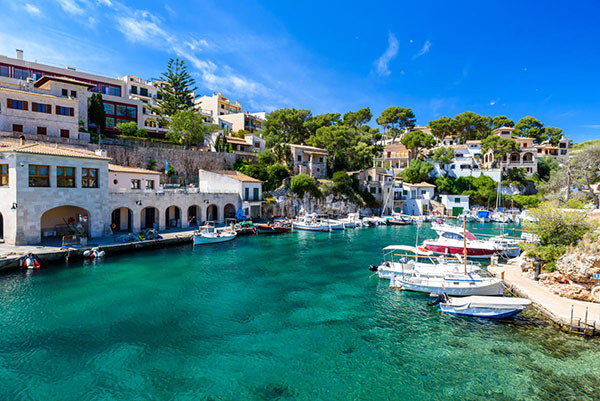 picturesque view of cala figuera with boats in majorca