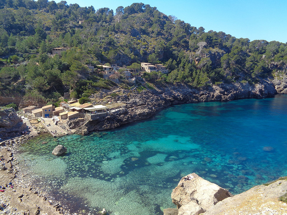 view from above of cala deia mallorca with turquoise waters