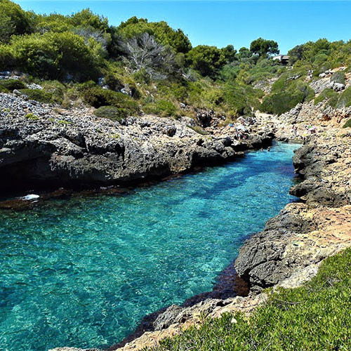 Cove Cala Murta in Mallorca with cristal clear water, well hidden beach