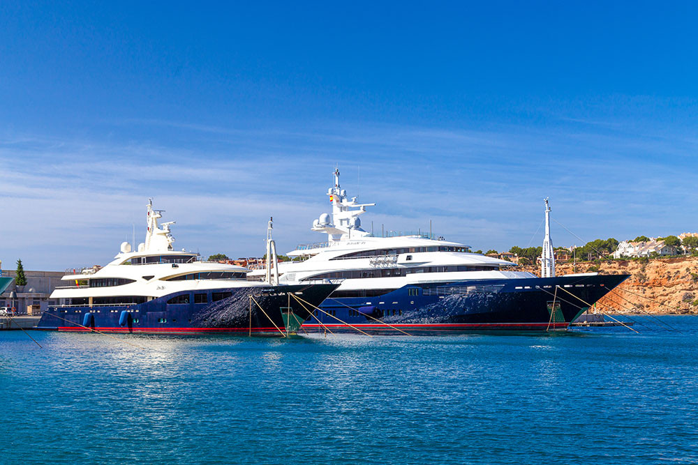 two mega yachts in Port de Adriano Majorca southwest
