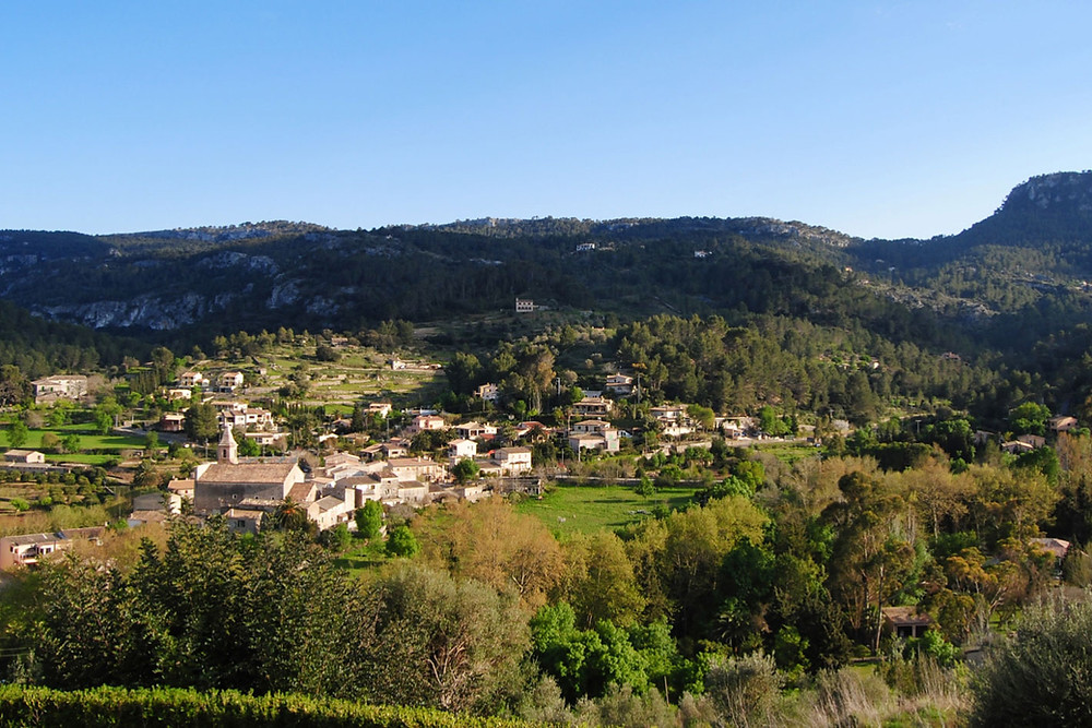 Village of puigpunyent in mallorca surrounded by mountains