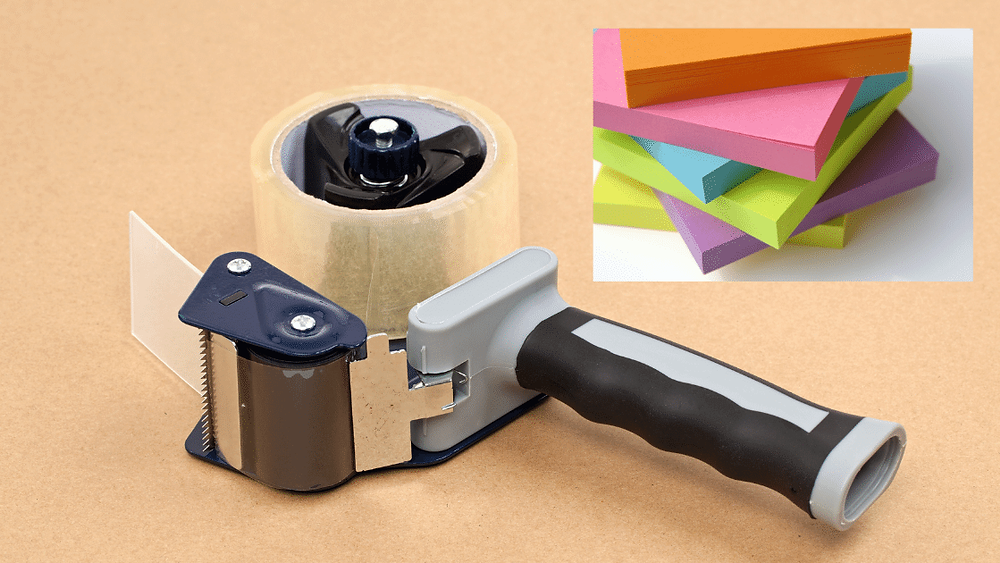 Tape gun and Post-it notes for moving