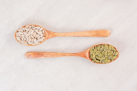 two-wooden-spoon-sunflower-pumpkin-seeds