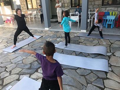 teaching trauma recovery yoga to efugee