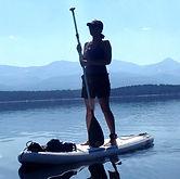 Kristi Ryan Steed paddleboarding on a mountain lake. Kristi Ryan Holistic Nutrition.
