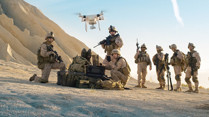 Soldiers are Using Drone for Scouting During Military Operation in the Desert._edited.jpg